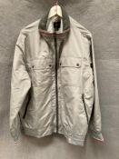 A Blue Harbour Storm Wear light grey waterproof jacket,