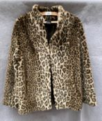 A lady's leopard patterned simulated short fur jacket,