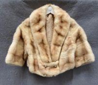 A lady's short fur jacket,