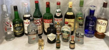 A collection of fourteen mainly part bottles of spirits and liqueurs (many at least half full)