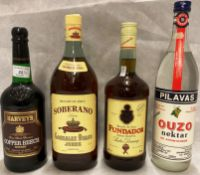 Four items - a one litre bottle of Soberano Brandy De Jerez (36% vol),