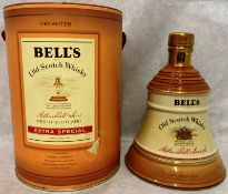 A porcelain decanter finished in 22 carat gold containing 75cl of Bell's Old Scotch Extra Special