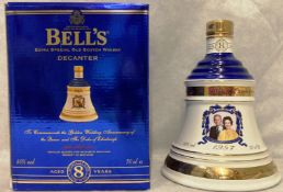 A porcelain decanter to commemorate the Golden Wedding Anniversary of the Queen and the Duke of