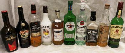 Ten various part bottles of spirits and liquors (range less than a quarter to three quarters full)
