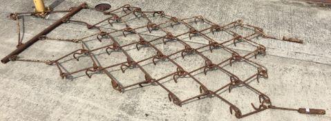 A chain harrow 215 x 140cm