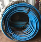 Large roll of blue MDPE pipe 32mm approximate length 50m
