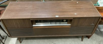 A Grundig stereogram with Grundig automatic 60 turntable in teak effect case 148cm long complete