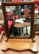 A small pine swing toilet mirror
