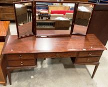 A Stag dark mahogany finish mirror back five drawer dressing table 154cm