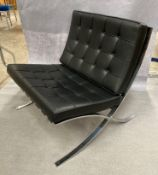 A KNOLL STUDIO BARCELONA CHAIR with padded black leather upholstery on chrome frame 75cm wide,