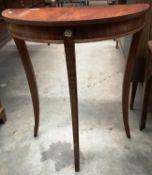 A mahogany finish demi lune hall table,