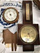 A small circular wall barometer,