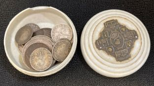 Small religious trinket box filled with silver coins