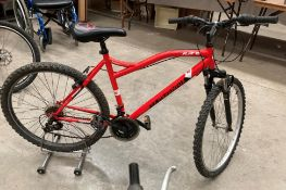 """A Muddy Fox Flare 18 speed mountain bike in red - 20 """" frame"""