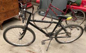 "A black metal framed 21 speed mountain bike 18"" frame - missing hand grips"