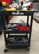 Snap-on black plastic 3 tier mobile work trolley and contents - assorted fuses, screws,