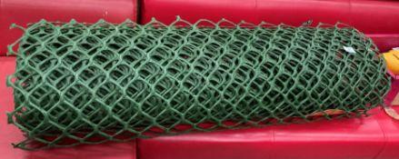 A green plastic heavy duty garden mesh netting roll approximately 10m x 1m