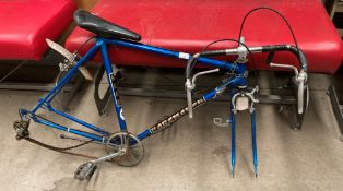 A Puch Pacemaker blue metal racing bike frame with drop handle bars and seat