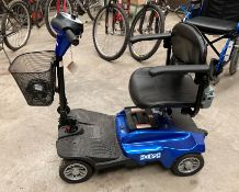 A Care Co Eclipse four wheel mobility scooter in blue complete with charger and key (we have now
