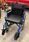 An Atlas Lite blue metal framed wheelchair with footrests