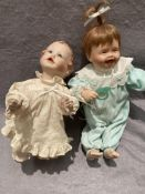 Two assorted porcelain dolls,