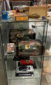 Four assorted Burago die-cast Jaguar cars - 1948 XK120 Roadster, 48 Roadster X2, E Cabriolet 1961,