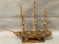'Cutty Sark' 1860 model boat on stand, wood inlaid with shell,