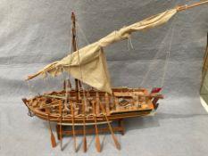 'Nauticalia' London, a wooden model boat, approximately 61cm long x 54cm high,