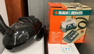 Two items - a Daewoo 1500 wall vacuum cleaner and a Black & Decker KX3300 steam wall paper stripper