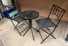 Small three piece patio set comprising black metal circular table 48cm dia and two black metal