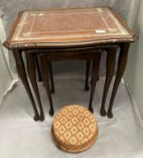 A nest of three coffee tables with brown tooled leather effect tops with inset glass and a small