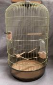 A birdcage with domed top approximately 70cm high x 40cm dia