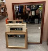A wood framed wall mirror 97 x 66cm and three other smaller wall mirrors (4)