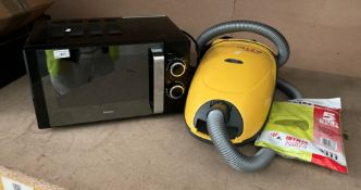 A Breville B17E9CMSB microwave oven and a Goblin Aztec 1200 vacuum cleaner (2)