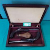 A pair of French percussion rifled target pistols,