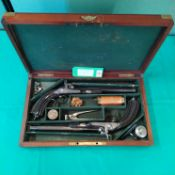 A fine pair of cased continental percussion rifled target pistols,