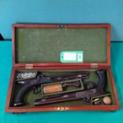 A cased pair of saw handle percussion target/duelling pistols by Holden Liverpool,