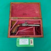 A continental percussion pocket pistol with concealed trigger,