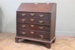 "An early 19th Century mahogany bureau on bracket feet, original hardware, width 38"", depth 20"","