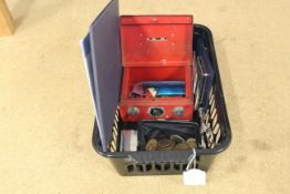 A small cash tin with various collectors Crowns and purse,
