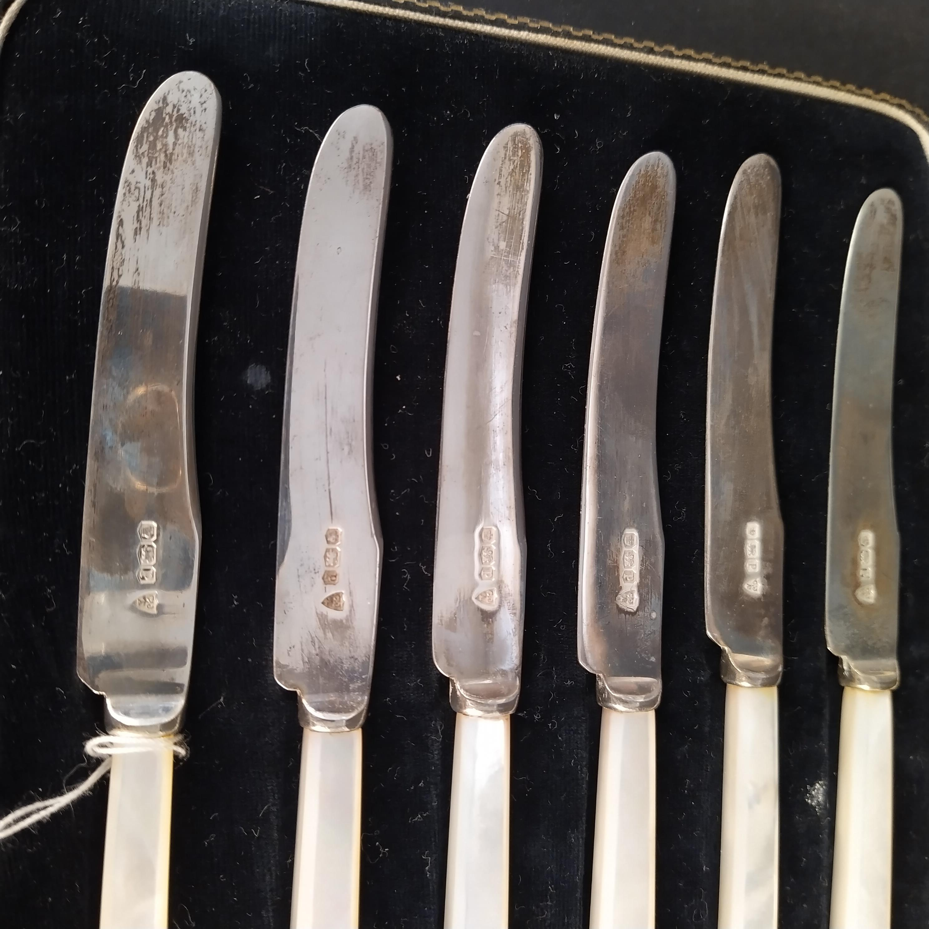 A cased set of six silver bladed mother of pearl handled butter knives, - Image 2 of 3