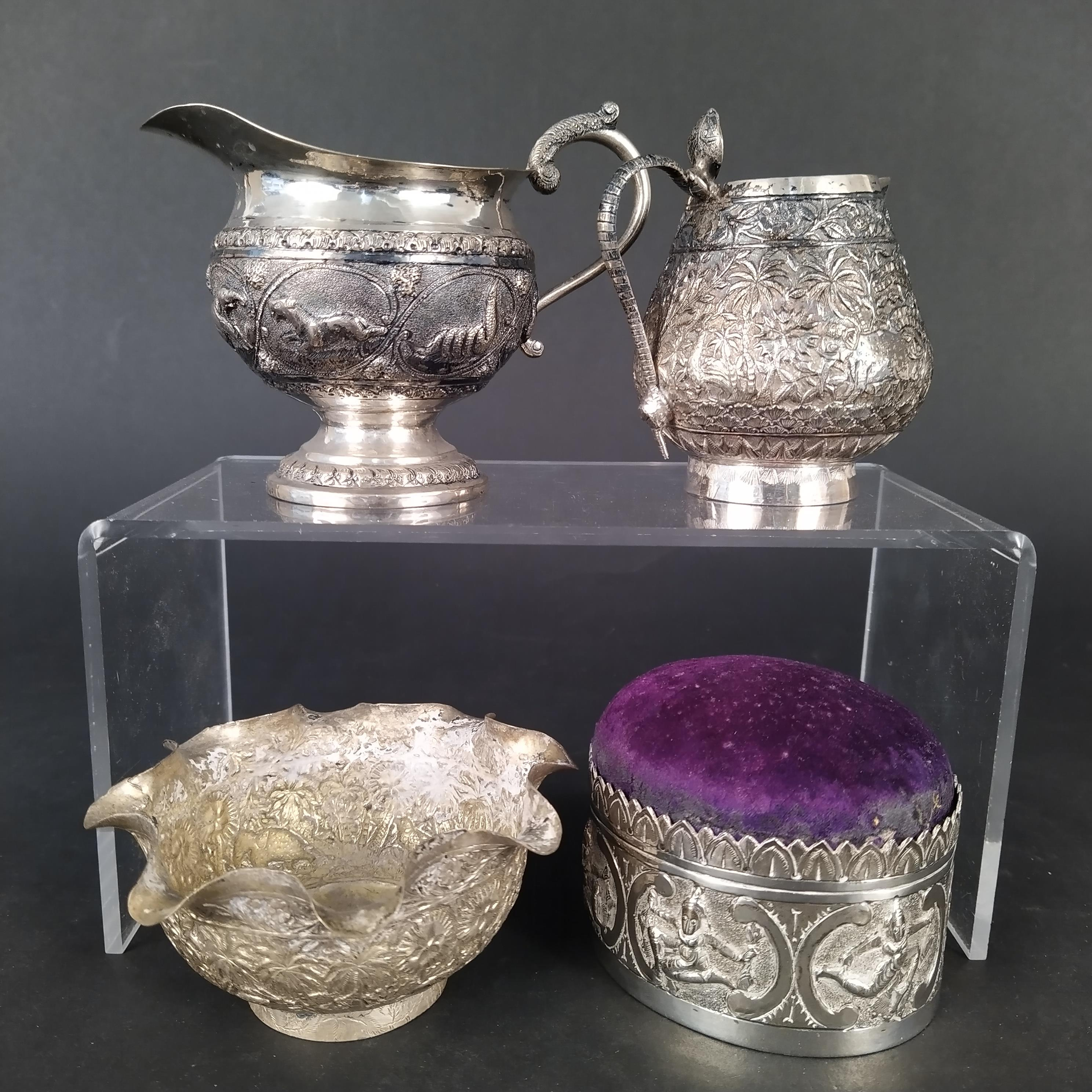 A mixed lot of Indian white metal items including jugs,