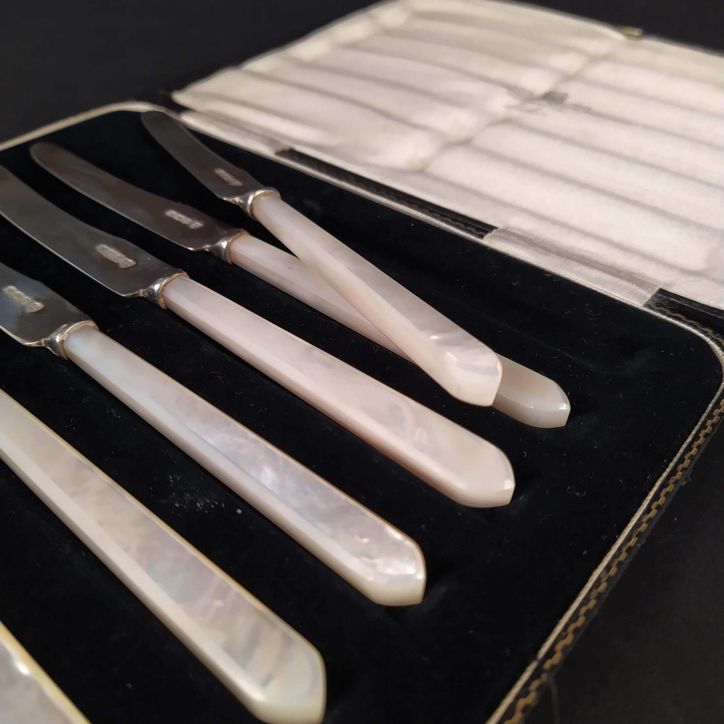 A cased set of six silver bladed mother of pearl handled butter knives, - Image 3 of 3