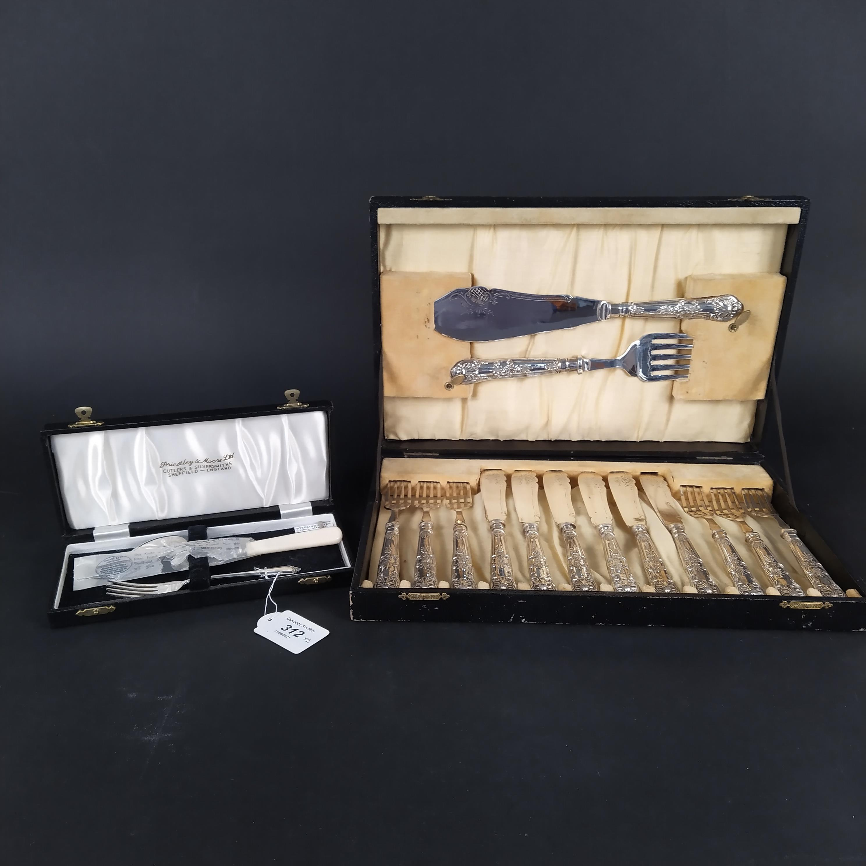 A cased silver handled six place fish cutlery with servers,