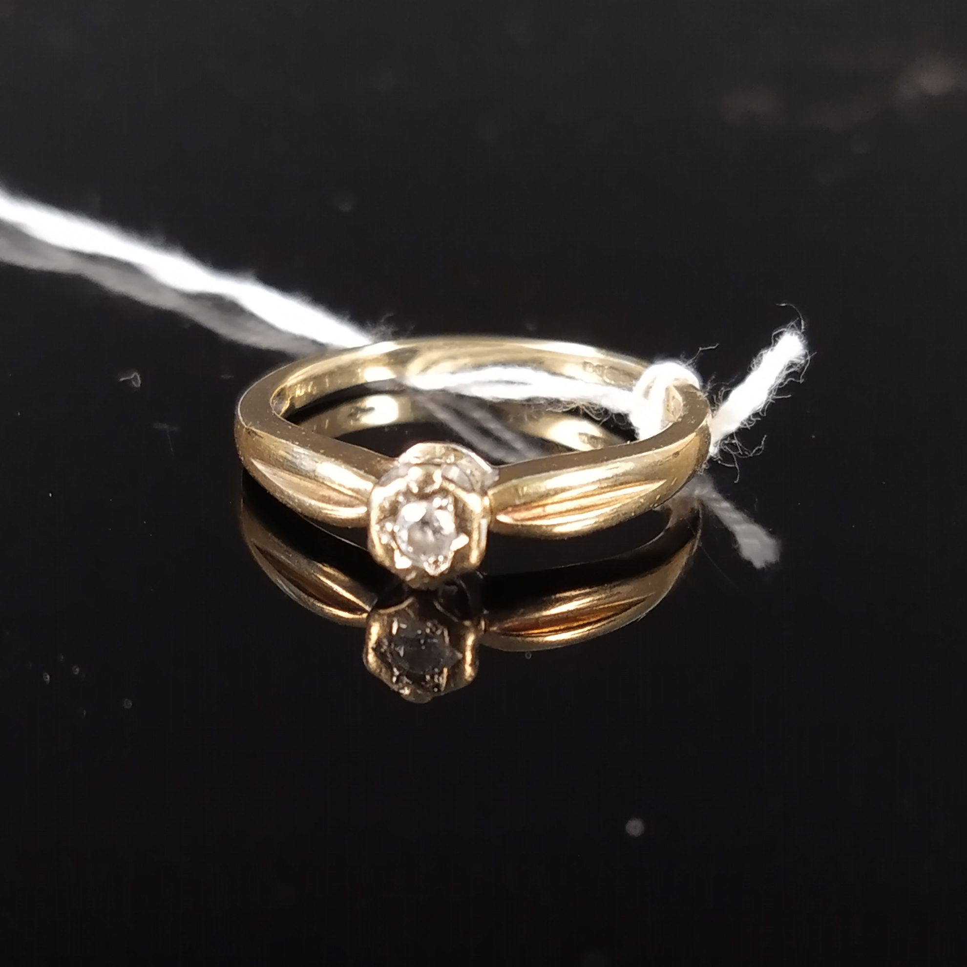 A 9ct gold solitaire diamond ring, size M 1/2, approx 1.