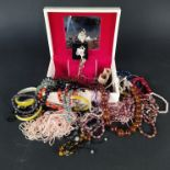 A quantity of costume jewellery including necklaces,