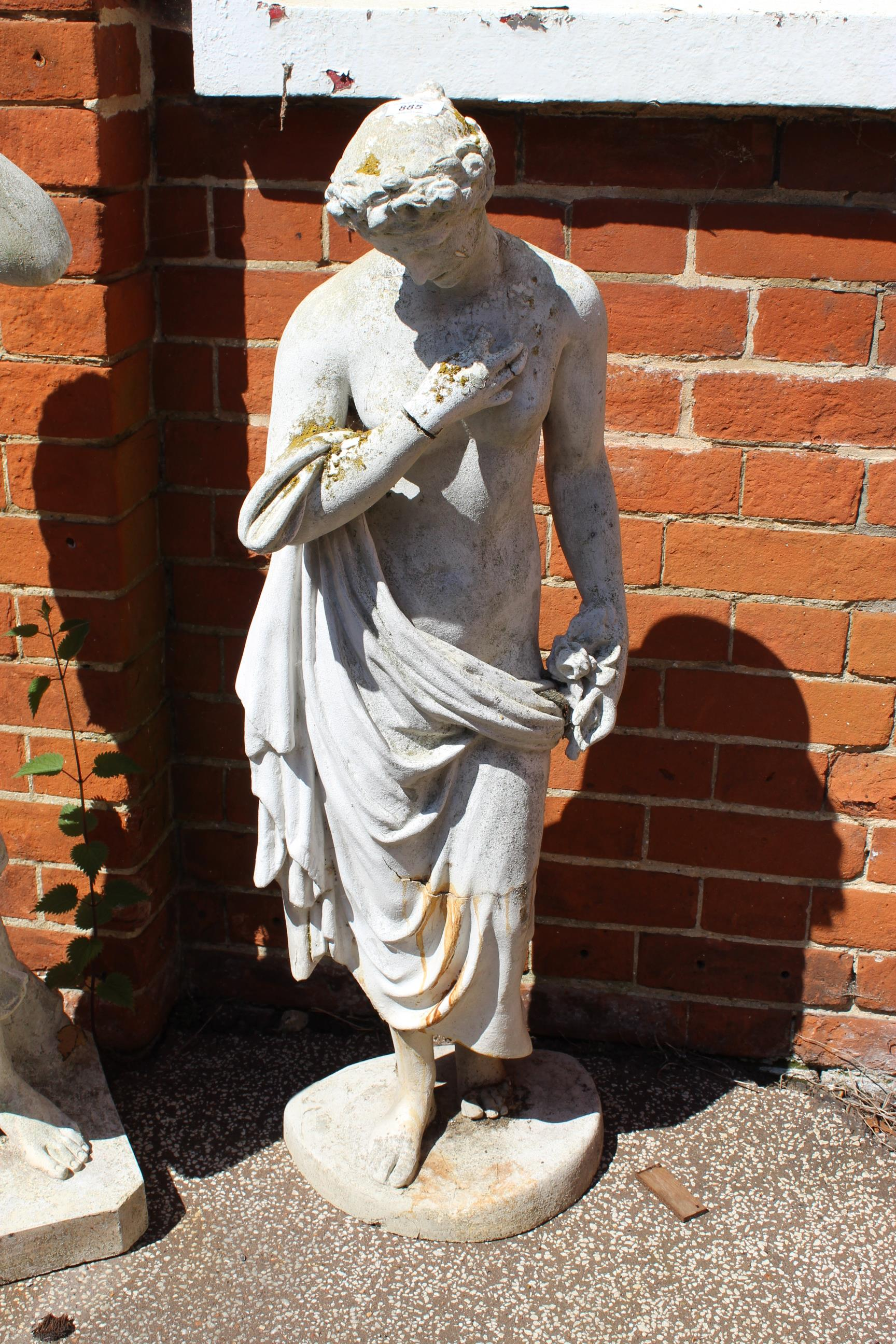 A fibre glass statue of a Greek lady,