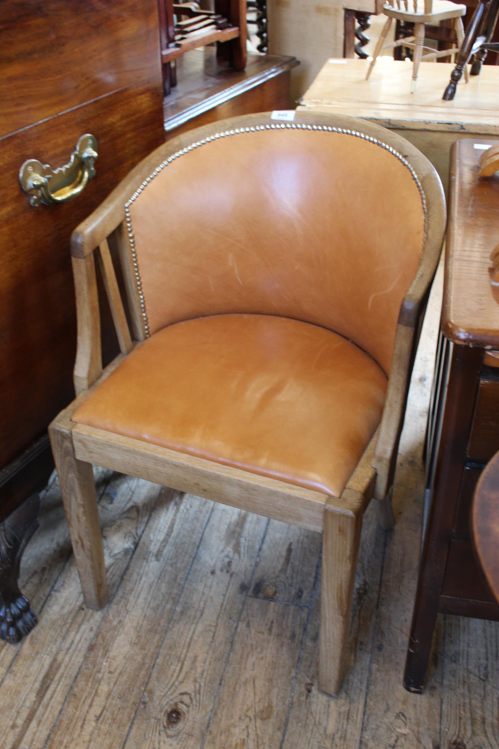 A 1930's oak framed leather covered desk chair