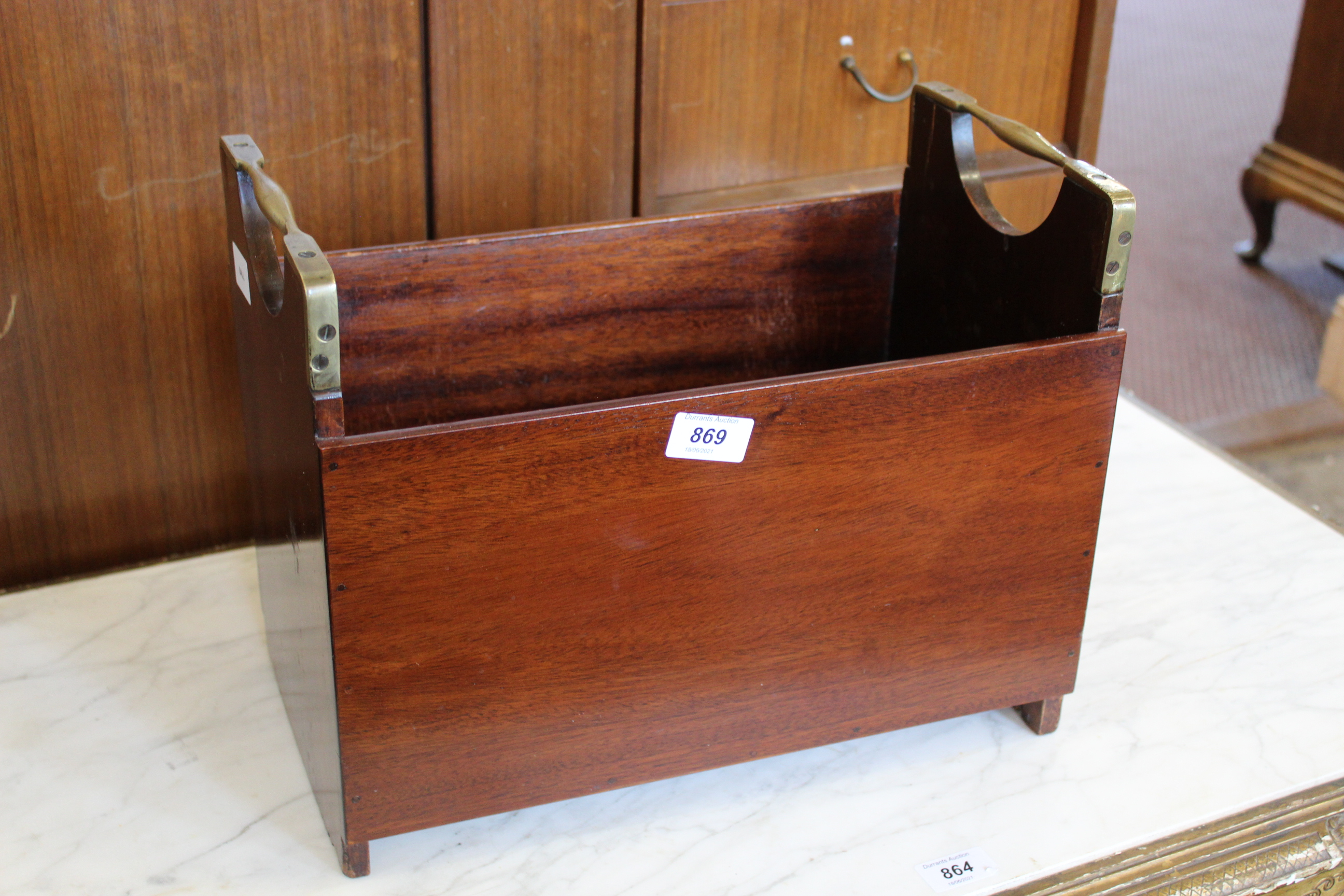 A mahogany book trough with brass carrying handles
