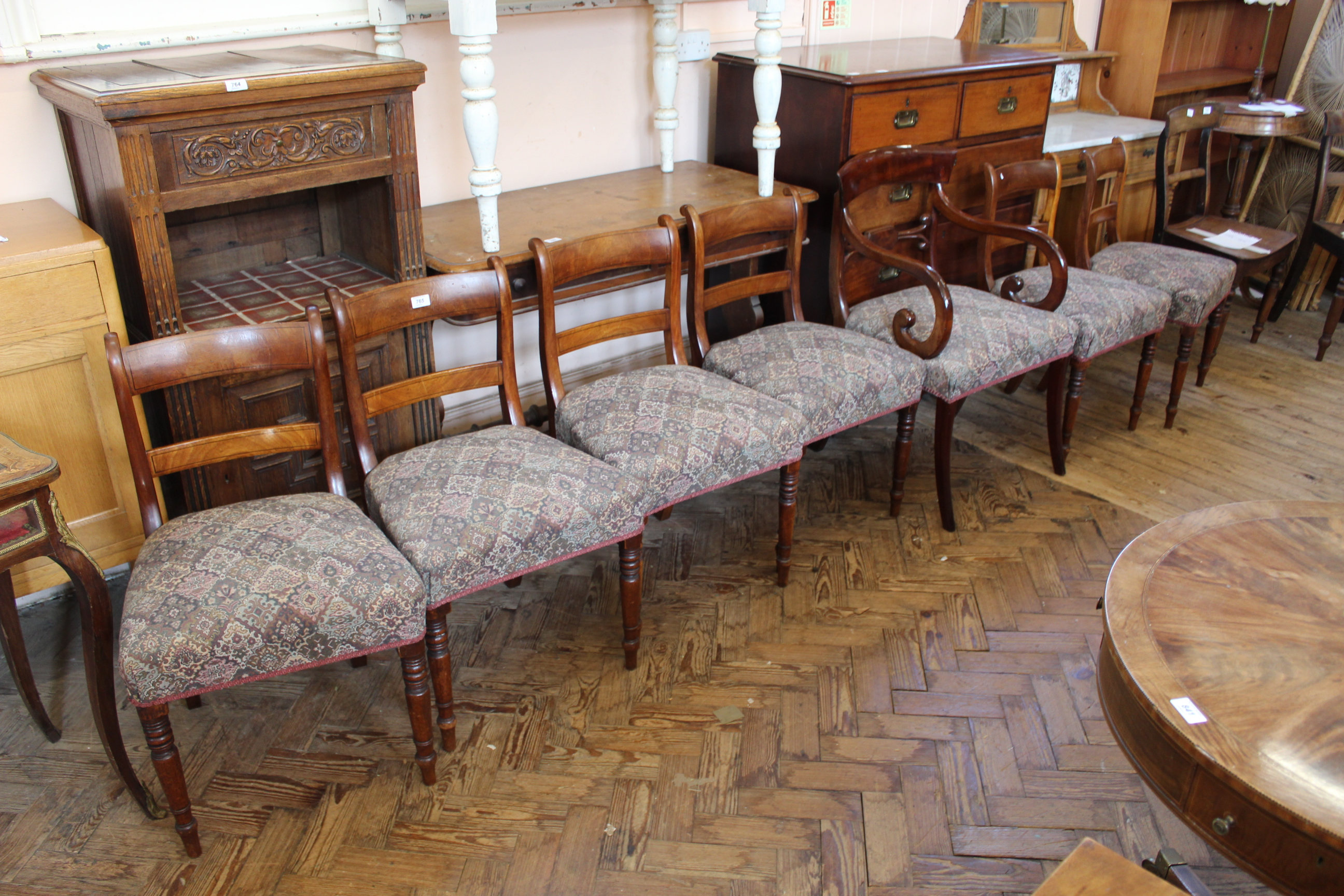 A set of six 19th Century mahogany dining chairs plus one Regency carver chair